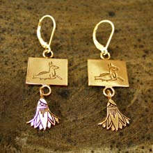 capricorn earrings in Gold